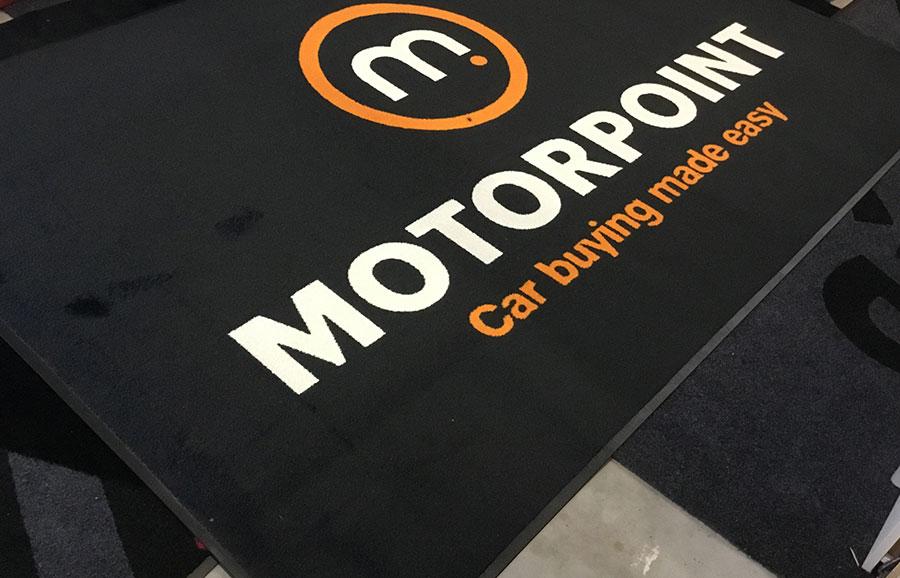 Een entreemat met logo